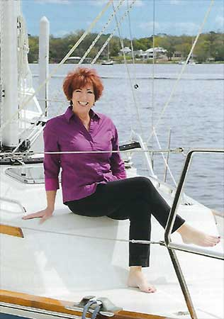 BARBARA BURKE on a sailboat